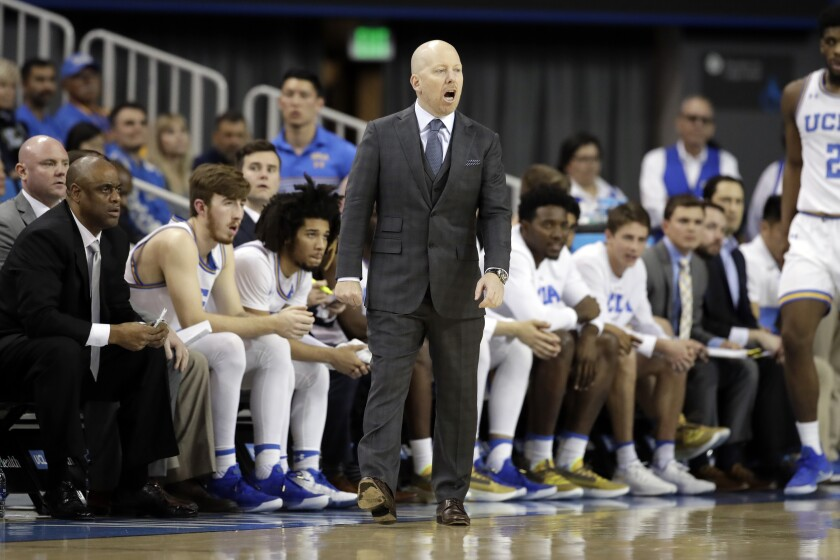 UCLA coach Mick Cronin instructs his players during a win over Washington State on Feb. 13.