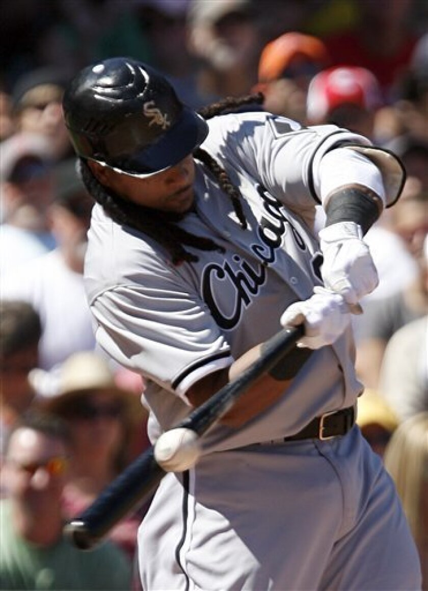 Chicago White Sox's Manny Ramirez (99) hits a single in his first at-bat during the second inning of the first MLB baseball game in a day-night double header, Saturday, Sept. 4, 2010, at Fenway Park in Boston. (AP Photo/Mary Schwalm)