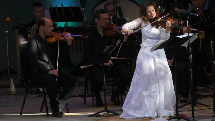 Violinist Patricia Kopatchinskaja concludes the Ojai Music Festival as soloist in Ligeti's Violin Concerto with the Mahler Chamber Orchestra at the Libbey Bowl on Sunday afternoon.