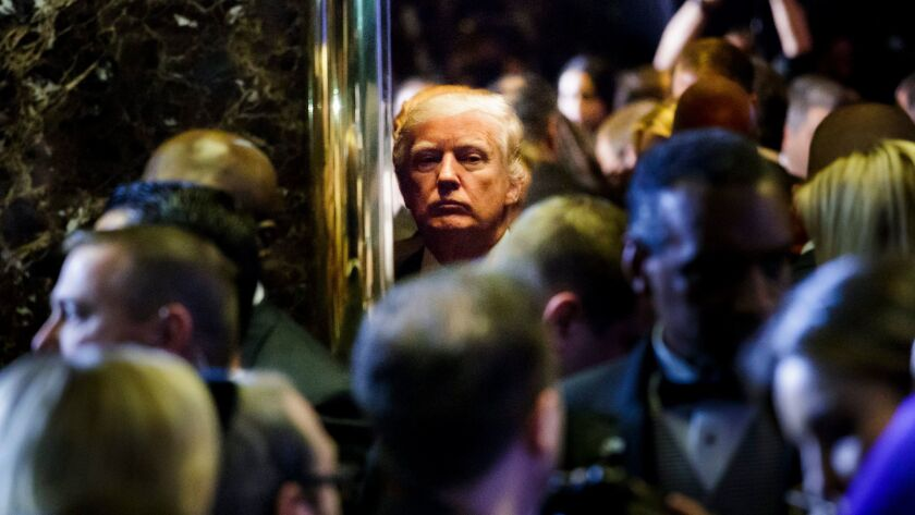 President-elect Donald Trump gets on an elevator after holding a press conference in the lobby of Trump Tower in New York.