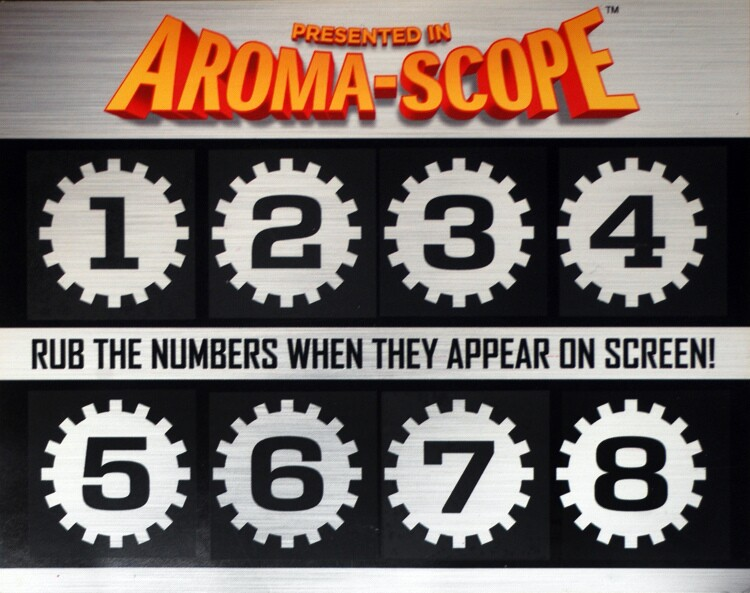 """In honor of Julia Child's 100th birthday, we take a look back at several olfactory films that we wouldn't mind taking a whiff of ... and some that we'd like to keep our noses away from. The Aroma-Scope card from 2011's """"Spykids: All the Time in the World in 4D"""" offers a unique scent to be scratched on cue during the movie. So how does it work? When you enter the theater and collect your 3-D glasses, you also get a postcard embedded with 8 squares that are numbered. When a digit flashes on screen, it's time to scratch the square with that number and inhale. Read on for other movies that should (or should not have) offered the olfactory experience."""