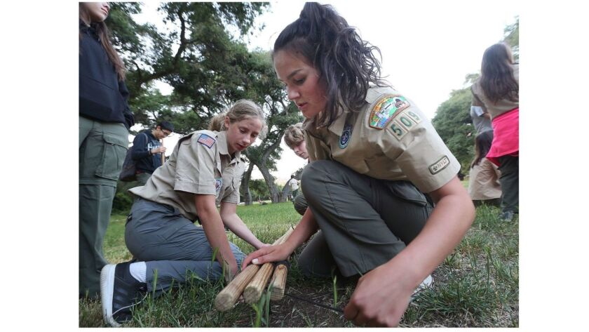 Senior patrol leader Lainy Dickson, 16, of La Crescenta, and scout Allison King, 16, of La Canada, u