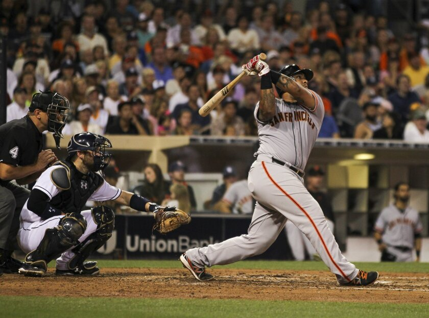 The Giants' Hector Sanchez hits a grand slam in the sixth inning. The Giants went on to beat the Padres 9-3 at Petco Park in San Diego on Tuesday, July 21, 2015.
