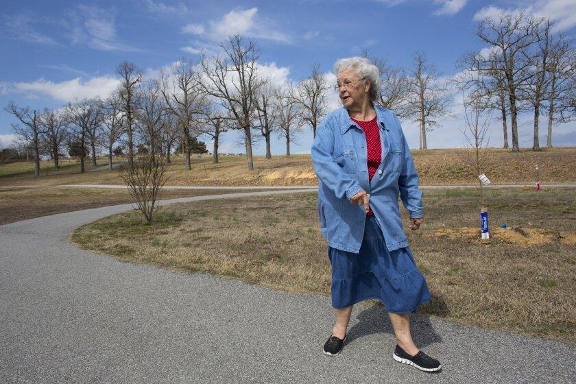 Winnie Abbott walks a short trail at City Park in Cave City, Ark. The 80-year-old great-grandmother recently had her knee replaced by a surgeon participating in a statewide effort in Arkansas to improve care.
