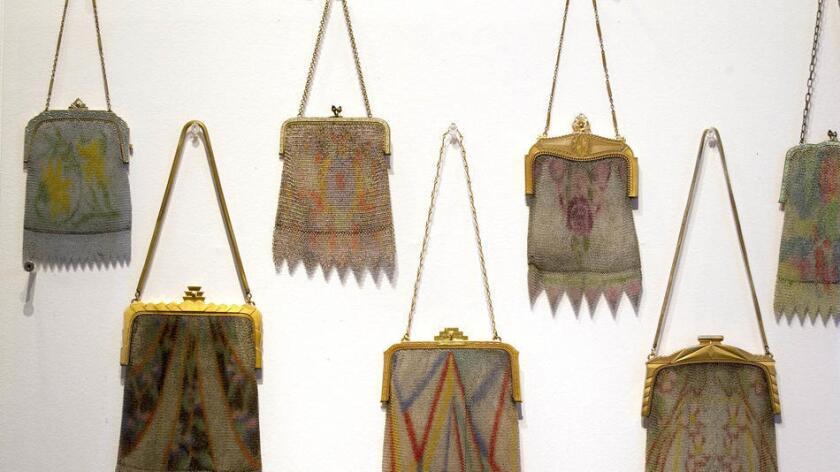 Some of the 100 handbags on exhibit. (John Gibbins/Union-Tribune)