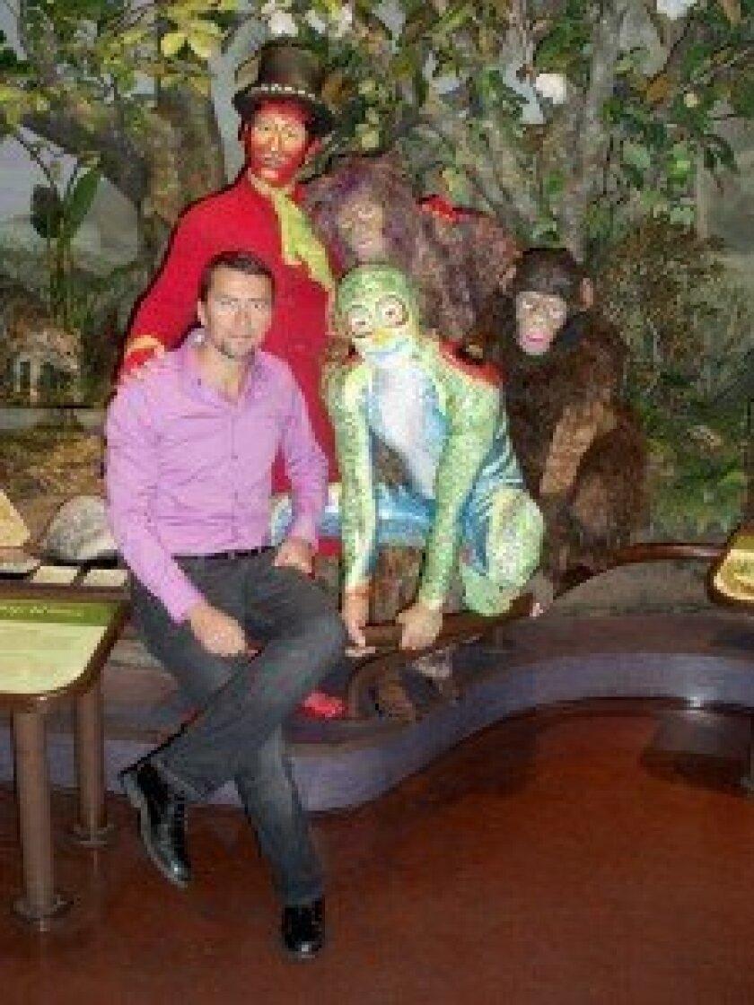 Ante Ursic (tracker), Yann Arnaud (caveman), Joe Putignano (monkey), Caoliang Wang (frog), with Cirque du Soleil artistic director Tim Smith, blending into a Natural History Museum exhibit. Photo/Rocky Smolin