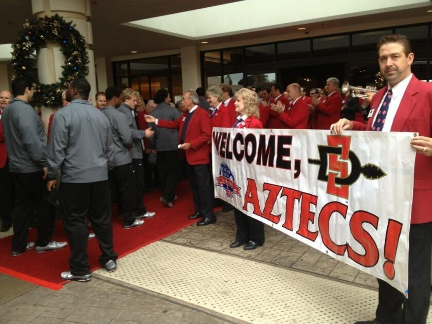 The San Diego State Aztecs check into the Sheraton on Harbor Island Drive to kick off Poinsettia Bowl week.