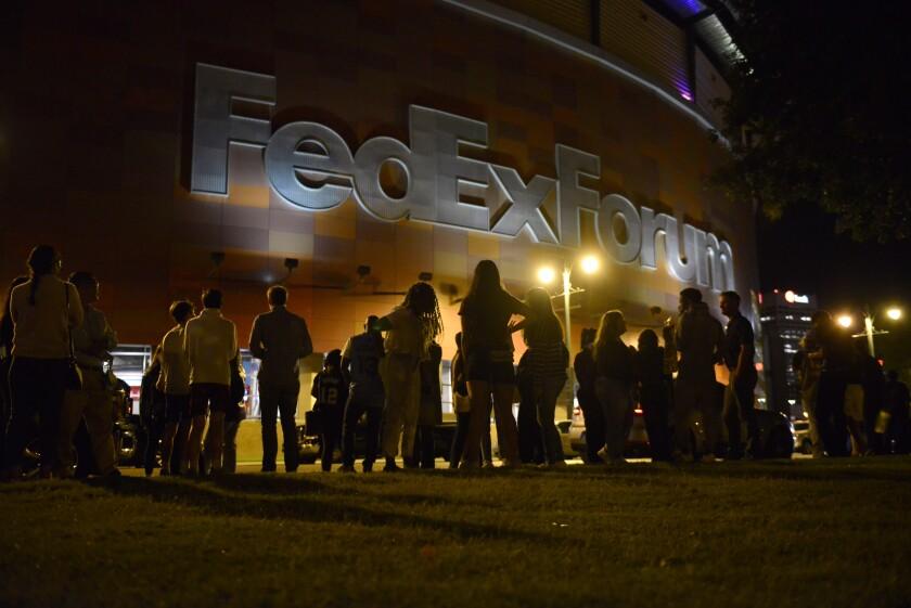 Fans wait outside FedExForum after a fire alarm went off during an NBA preseason basketball game between the Milwaukee Bucks and the Memphis Grizzlies Tuesday, Oct. 5, 2021, in Memphis, Tenn. (AP Photo/Brandon Dill)
