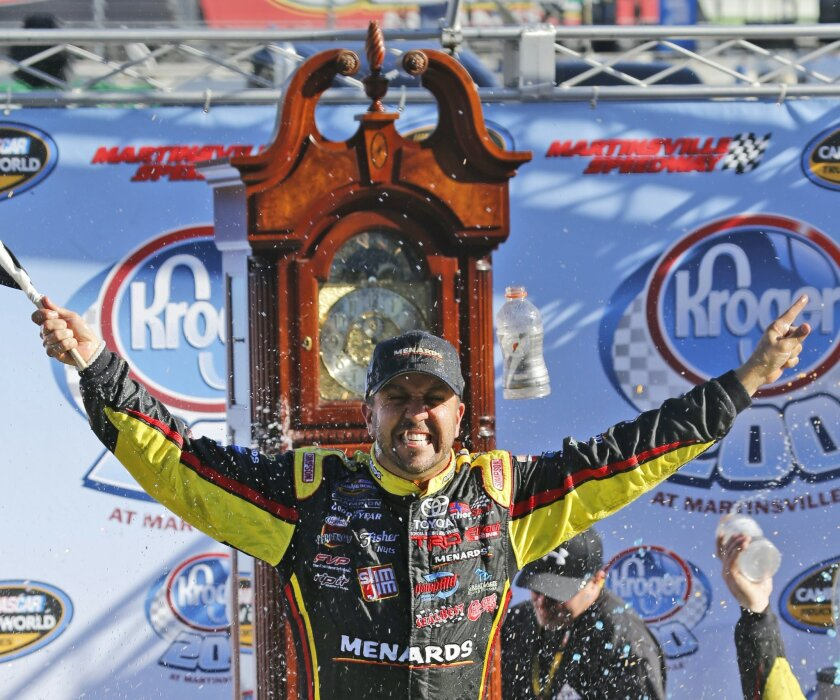 Camping World Truck Series driver Matt Crafton (88) celebrates winning the NASCAR Camping World Truck auto race at the Martinsville Speedway in Martinsville, Va., Saturday, Oct. 31, 2015.    (AP Photo/Steve Helber)
