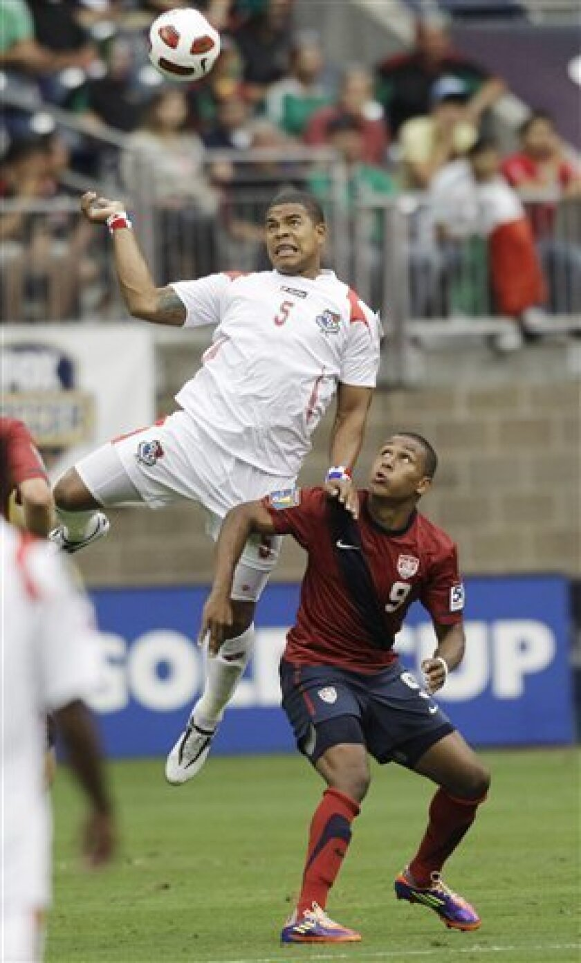Panama's Roman Torres (5) and United States' Juan Agudelo (9) go after the ball during the first half of a CONCACAF Gold Cup semifinal soccer match Wednesday, June 22, 2011, in Houston. (AP Photo/David J. Phillip)