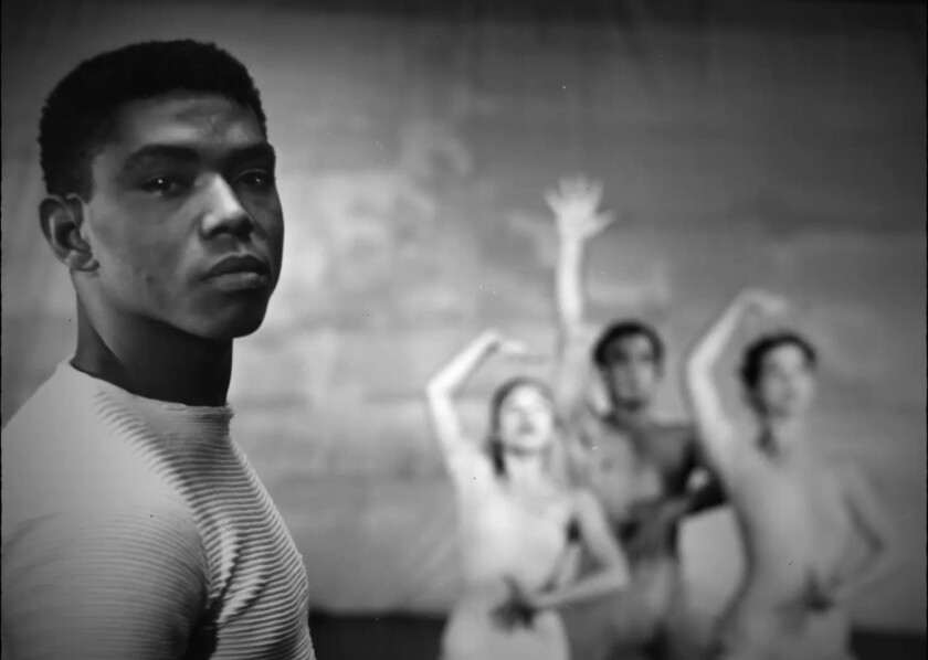 """A young man with three dancers in the background from the documentary """"Ailey."""""""
