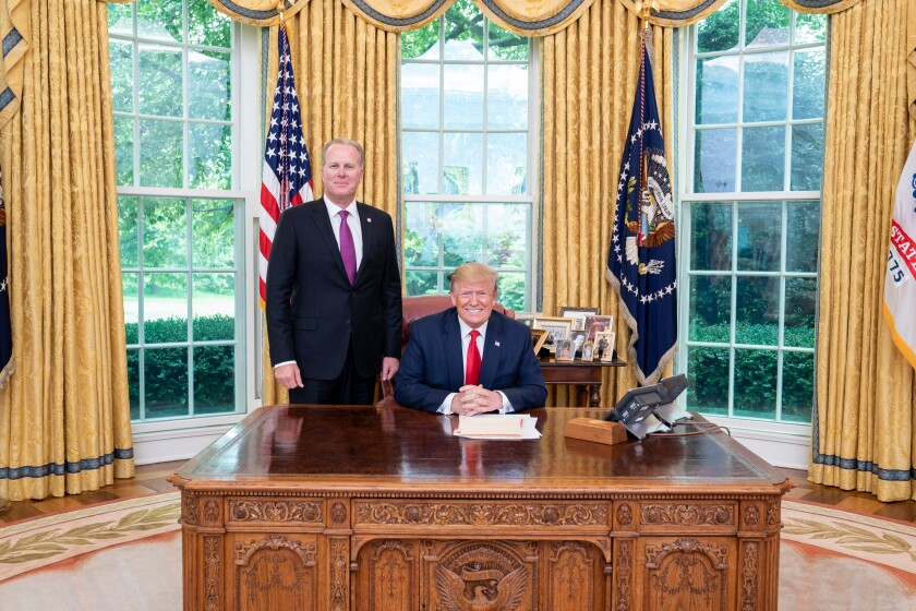 Then-San Diego Mayor Kevin Faulconer stands next to President Trump in the Oval Office in June 2019