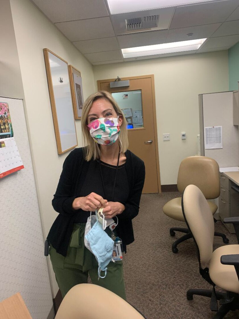 Staff at Rady Children's in a mask donated by Joey's Wings.