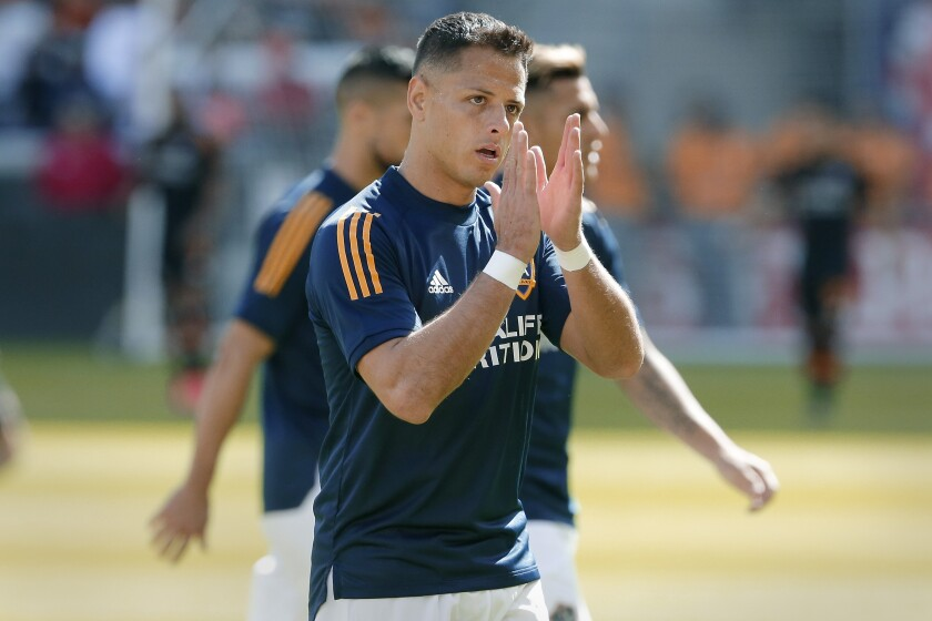 "Galaxy forward Javier ""Chicharito"" Hernandez applauds fans during warmups."