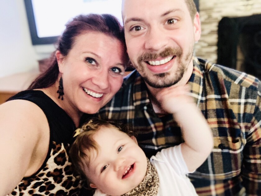 Marzena and Michael Mosco with their baby girl Hanna. on Thanksgiving Day 2020.