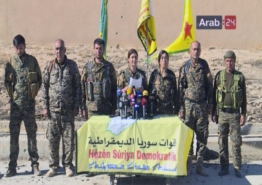 Officials with the U.S.-backed Syria Democratic Forces hold a news conference in Ein Issa in northern Syria