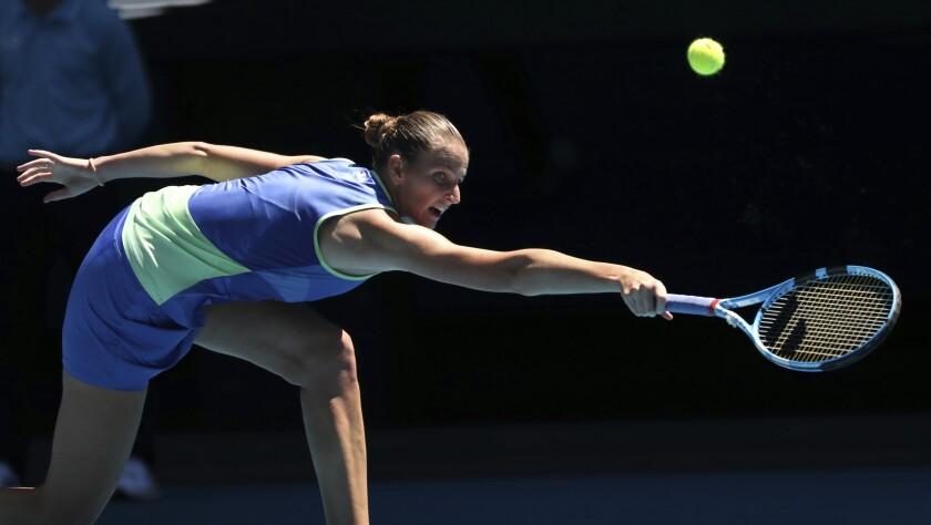 Karolina Pliskova of the Czech Republic makes a return hit to Anastasia Pavlyuchenkova of Russia during their third round match Jan. 25 at the Australian Open.