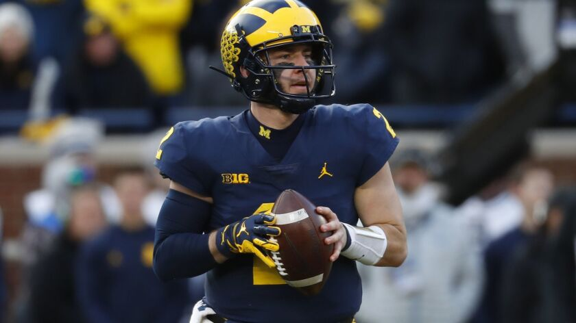 Michigan quarterback Shea Patterson looks to throw a pass against Penn State in November 2018.