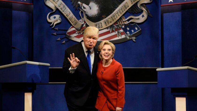 """FILE - In a Saturday, Oct. 1, 2016 file photo provided by NBC, Alec Baldwin, left, as Republican presidential candidate, Donald Trump, and Kate McKinnon, as Democratic presidential candidate, Hillary Clinton, perform on the 42nd season of """"Saturday Night Live, """" in New York."""