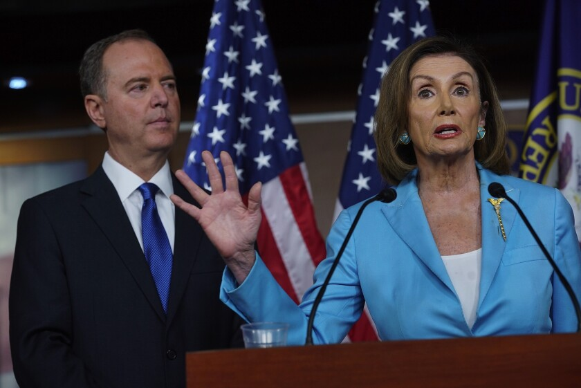 Adam Schiff and Nancy Pelosi at a press conference