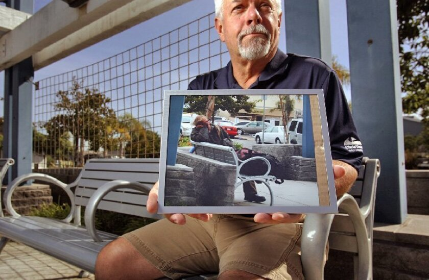 Howard Jones held a picture of Jeff Pastorino, a homeless man who spent at least 15 years on the streets of Point Loma. Pastorino was a mentally ill drifter who never drifted.