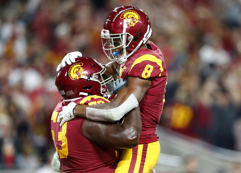 USC wide receiver Amon-ra St. Brown is congratulated by teammate Drew Richmond after scoring a touchdown against Stanford on Sept. 7.