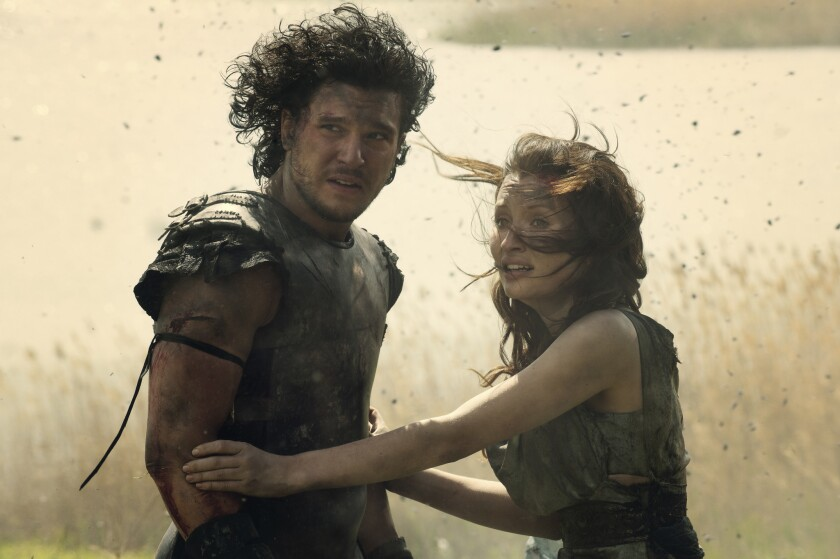 """Kit Harington as Milo and Emily Browning as Cassia in """"Pompeii."""""""