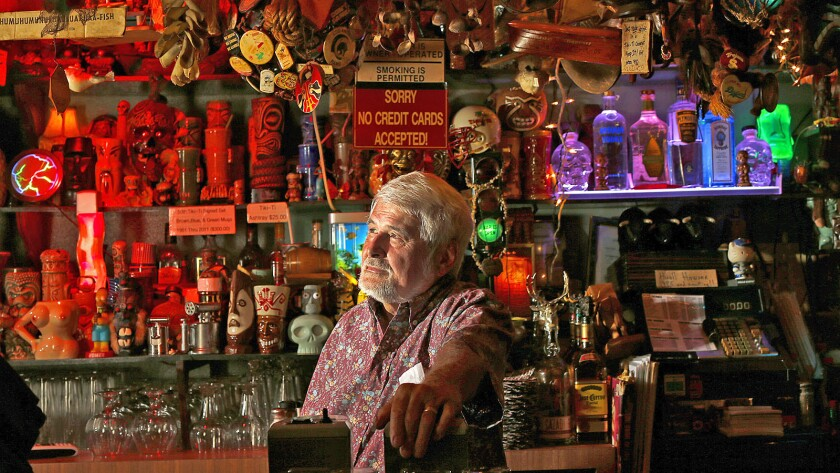 """The Los Feliz tiki bar Tiki-Ti is closed only """"indefinitely"""" and will reopen in the future, says owner Mike Buhen. Above, Buhen at the bar in April."""