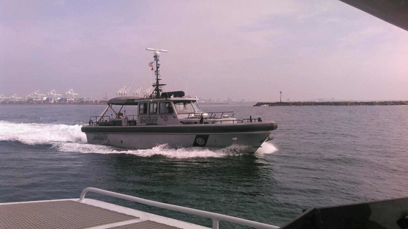 A Los Angeles County sheriff's boat heads out to conduct radiation screening of boats arriving at th