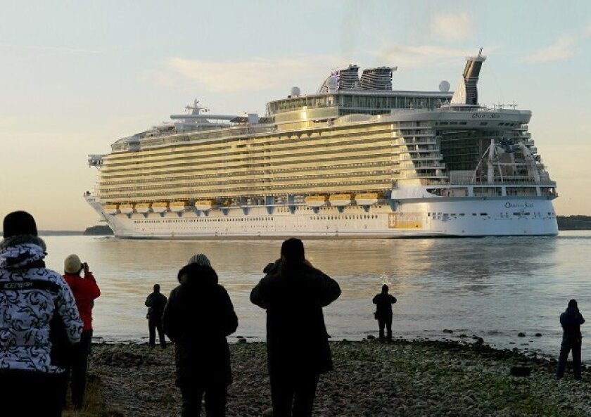 The $1.5 billion Oasis of the Seas, the world's largest cruise ship, left the shipyard in Turku, Finland, yesterday en route to its Fort Lauderdale, Fla.-area home port. (Associated Press / Royal Caribbean)
