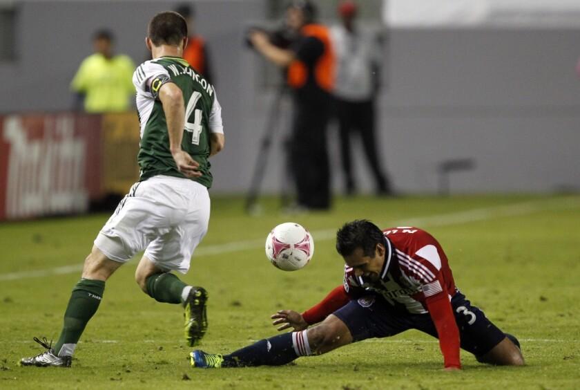 Portland Timbers midfielder Will Johnson steals the ball from Chivas USA defender Mario de Luna back in October.