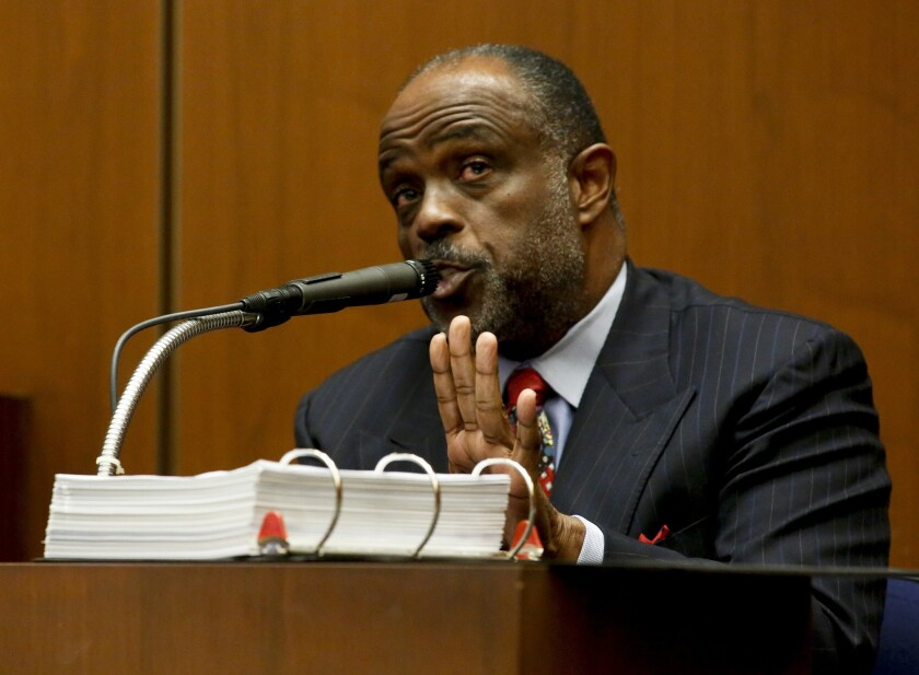 A jury found state Sen. Roderick Wright, shown testifying in his own defense earlier this month, guilty of eight felonies involving lying about where he lived.