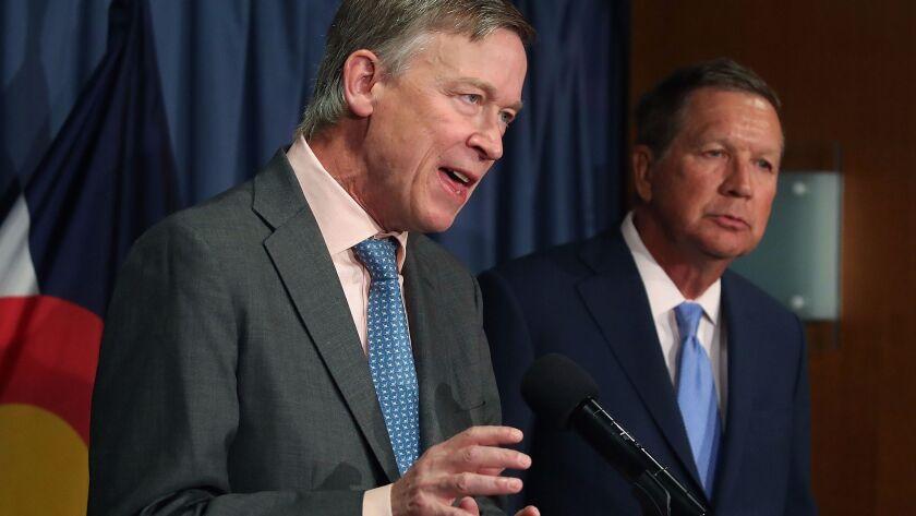 Gov. John Hickenlooper (D-Colo.), left, and Gov. John Kasich (R-Ohio) participate in a bipartisan news conference to discuss the Senate healthcare bill in Washington.