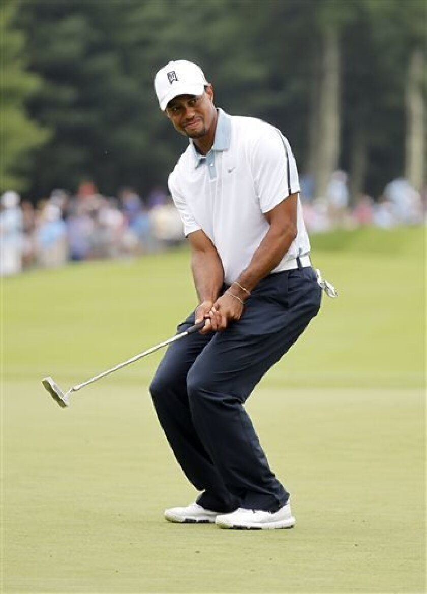 Tiger Woods reacts to missing a birdie putt on the 10th green during the second round of the Deutsche Bank Championship golf tournament in Norton, Mass., Saturday, Aug. 31, 2013. (AP Photo/Stew Milne)