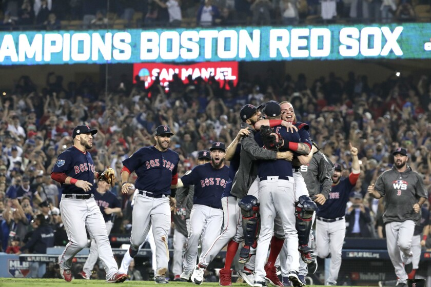 he Boston Red Sox celebrate winning the World Series