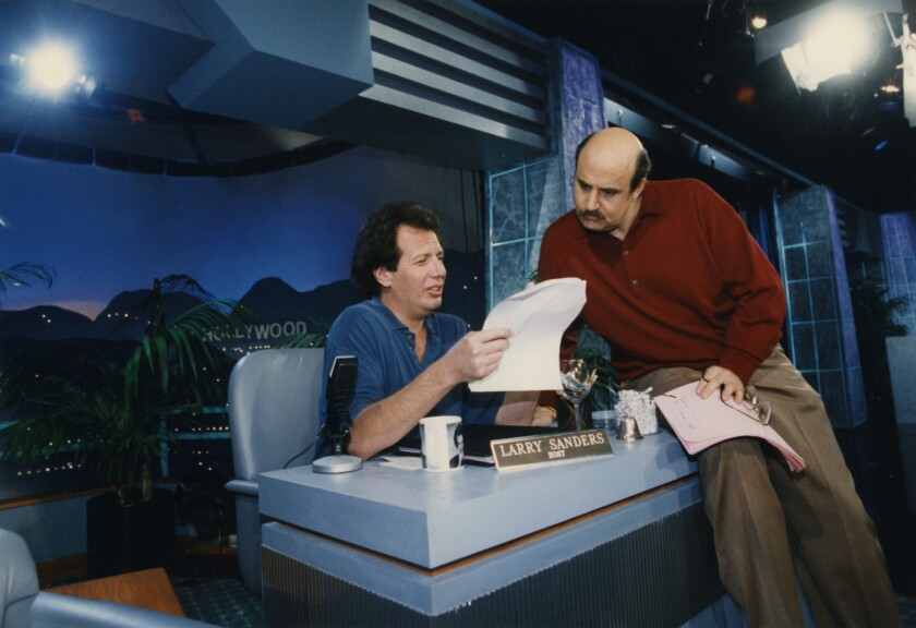 "Garry Shandling, left, and Jeff Tambor on the set of ""The Larry Sanders Show."""