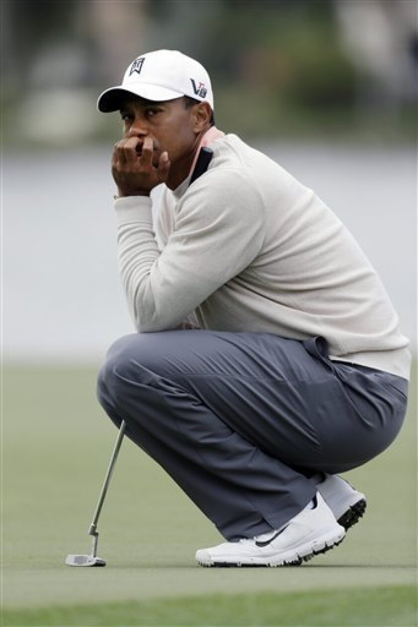 Tiger Woods waits to putt on the 18th hole during the first round of the Honda Classic golf tournament, Thursday, Feb. 28, 2013 in Palm Beach Gardens, Fla. (AP Photo/Wilfredo Lee)