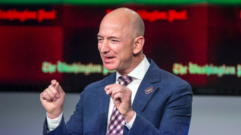 FILE - In this Jan. 28, 2016, file photo, billionaire Amazon founder and Washington Post owner Jeff