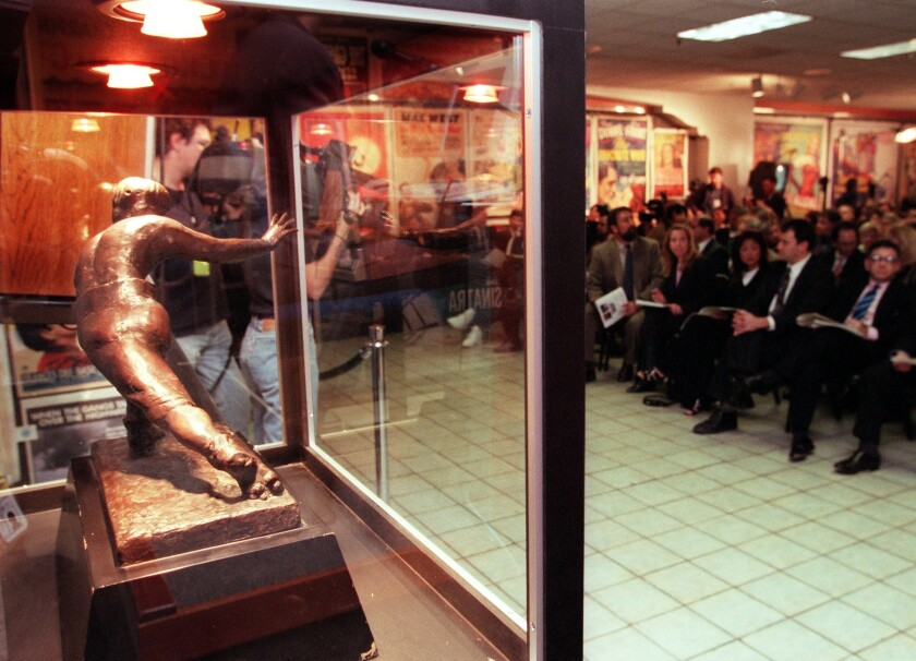 O.J. Simpson's personal Heisman Trophy, seen in 1999, was the centerpiece at a court-ordered auction at Butterfield and Butterfield that year. USC's trophy was stolen in 1994.
