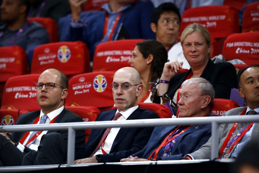 NBA Commissioner Adam Silver, second from left, attends the semifinal match between Argentina and France in the FIBA Basketball World Cup.