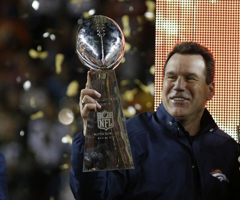 Denver Broncos' head coach Gary Kubiak holds the trophy after winning the NFL Super Bowl 50 football game against the Carolina Panthers, Sunday, Feb. 7, 2016, in Santa Clara, Calif. (AP Photo/Matt Slocum)