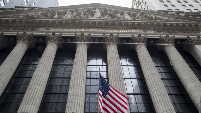 FILE - In this Nov. 20, 2018, file photo an American flag flies outside New York Stock Exchange. The