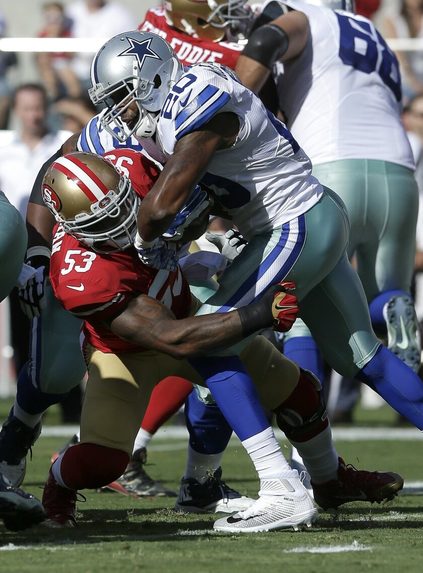 San Francisco 49ers linebacker NaVorro Bowman (53) tackles Dallas Cowboys running back Darren McFadden (20) during the first half of an NFL preseason football game in Santa Clara, Calif., Sunday, Aug. 23, 2015. (AP Photo/Jeff Chiu)