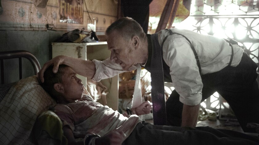 """Ben Daniels (right) plays a priest attempting an exorcism in a scene from Fox's """"The Exorcist."""""""