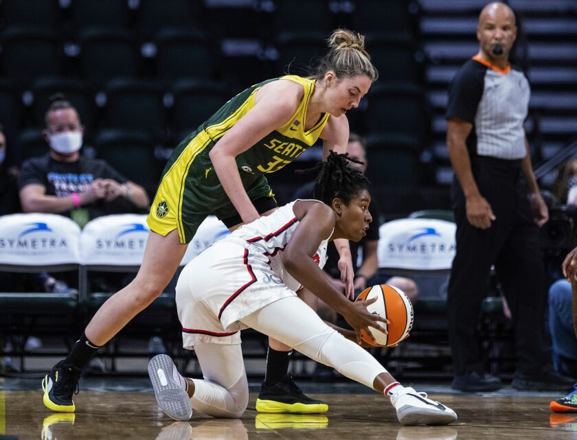 Washington Mystics' Ariel Atkins is defended by Seattle Storm's Katie Lou Samuelson during the first quarter of a WNBA basketball game Tuesday, Sept. 7, 2021, in Everett, Wash. (Dean Rutz/The Seattle Times via AP)