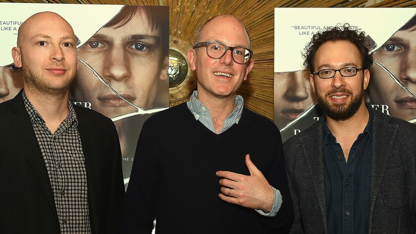 Lorin Stein, center, with Adam Wilson, left, and Teddy Wayne. Stein has resigned as editor of the Paris Review.