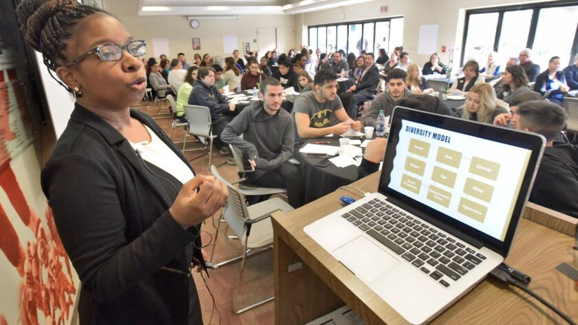 Keynote Speaker Alexandria Gurley, left, conducts a power-point workshop on diversity during the Third Annual Martin Luther King Jr. Interfaith Breakfast held in the Student Center Conference room at Glendale Community College in Glendale on Tuesday morning, January 16, 2018.