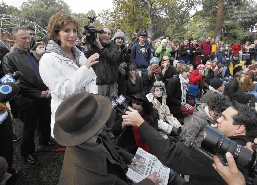 Chancellor Linda Katehi, left, at an Occupy UC Davis encampment on the campus in 2011, days after a controversial pepper-spraying incident by campus police.