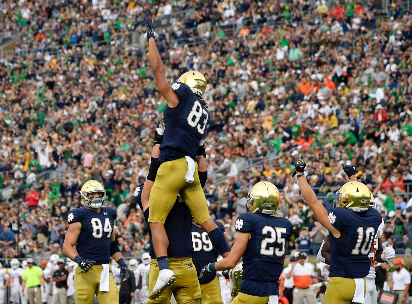 Notre Dame's Chase Claypool (83) celebrates with teammates after scoring a touchdown in the first half against Bowling Green on Saturday in South Bend, Ind.