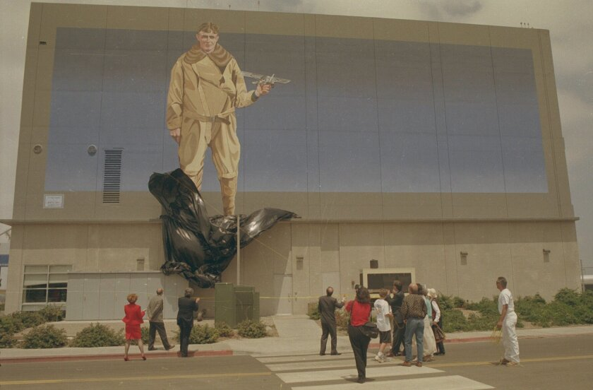 "June 25, 1997: The ""Lucky Spirit"" mural,, a 40-foot high, 100-foot-long painting of aviator Charles Lindbergh, is unveilded on the east wall of the communter terminal at Lindbergh Field. Nancee E. Lewis/The San Diego Union-Tribune"